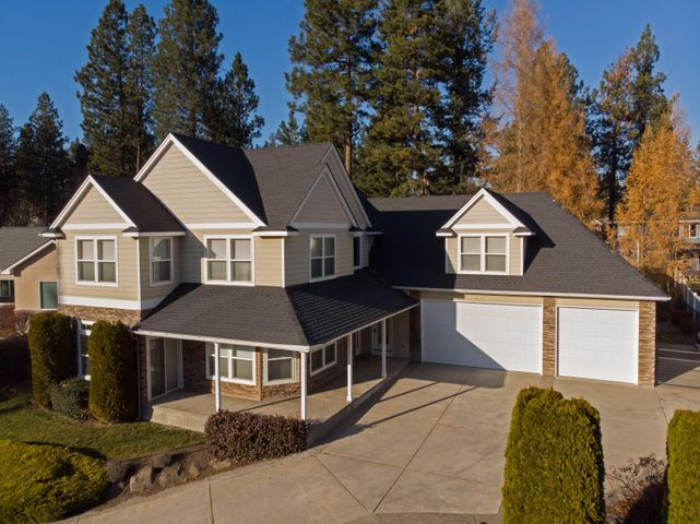 Riverside Harbor River View Home!  Situated right across the street from the Spokane River, the location of this home is hard to beat!  Enjoy views indoors and outdoors while relaxing on your covered front porch.  This 3,298 SF, 5 BR, 3 BA home comes on a large beautifully landscaped lot with fenced backyard. Home features a main floor master suite with jetted tub, living room with gas fireplace, main floor office, 4 bedrooms on the second level as well as a nice oversized bonus room above the 3-car garage.  HOA provides for community park and beach, picnic area, and Spokane River access. This is a special community and a great neighborhood!  Call today for your private showing!