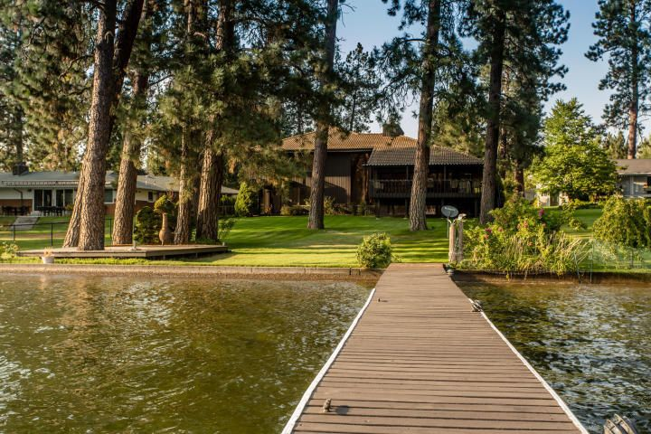 A beautiful Frank Lloyd Wright inspired 4 story home located on a gorgeous portion of the Spokane River. Constructed by a well knowlocal Architect, this home is located on a quiet private street but is central to shopping, restaurants and all conveniences in Post Fallsarea. Stunning water front home in a park like setting with spectacular views of the river and mountains. This 3 bedroom, 2.5 bath haseverything you could dream of. Huge kitchen with American walnut cabinets, large spacious rooms and high end finishings. Pellawindow, 100 yr roof, landscaped yard with sprinkler system and huge covered patio. 2.5 car attached garage and a 5 car detachedgarage with 14' RV door. Huge dock that can accommodate many boats including up to a 40'er an a covered 26'er. Ownership pridethroug