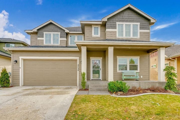 WOW!!! This show stopper is right across from Sorbonne Park! This phenomenal home boasts 6 BR / 4 BA / 3,476 Sq Ft in one of the most highly sought after neighborhoods in Coeur d'Alene! The huge open designed floor plan offers nearly 20 Ft tall ceilings which insure tons of natural light from oversize paneled windows. Hardwood floors, granite & quartz countertops and stainless steel appliances throughout. The master bedroom is guaranteed to delight with en suite bath, alongside a full basement to entertain guests replete with a fully equipped wet bar setup. All new carpet, upgraded cabinets and pantry area round out all the other high end finishes of this custom home. The backyard is meticulously landscaped and comes with a full pergola, concrete curbing + gardening area. Don't Hesitate!