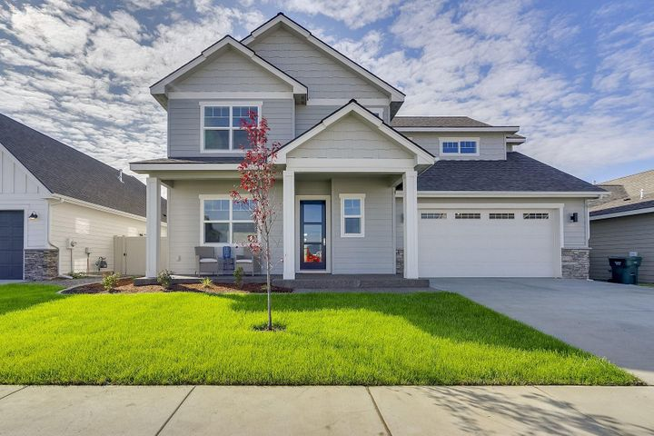 Award winning builder parade home, move-in ready! This popular Yellowstone floorplan boasts 4bd, 2.5ba and offers plenty of space throughout its two story plan. Amongst the many upgraded features of this home, you will find an open concept main floor living space complete with office, powder room, and drop zone mudroom off the garage.The kitchen is shines with Frigidaire Professional series appliances, cast farm sink, and Zephyr range hood and includes wrap around painted cabinets, quartz topped island, and pantry closet.The dining room is directly adjacent to the kitchen and offers double sliding doors onto the spacious covered patio, which overlooks the fully fenced and landscaped back yard.