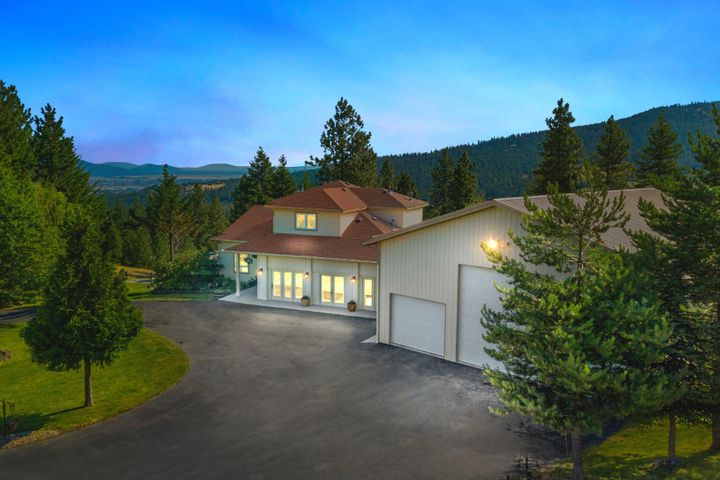 STUNNING MOUNTAINTOP LUXURY HOME + HUGE SHOP ON ACREAGE MEETS NORTH IDAHO FUN! This is the ''Man Cave''you've fantasized about! Close-in custom builtcontemporary home on 13+ acres with high speed internet capability, spectacular alpine views and a zip-line. This 5 bedroom, 4.5bath spacious home features gorgeous granite counter-tops, multiple fireplaces, and a woodstove. Chef's kitchen includes high-end appliances, ample prep space, walk-in pantry, warming drawer, mixer storage stand, alladjacent to the built-in wine bar with two beverage coolers leading to the laundry and mudroom featuring not one, but twosets of energy efficient washers and dryers. Motor around scenic trails on your idyllic forested property and you'll forget