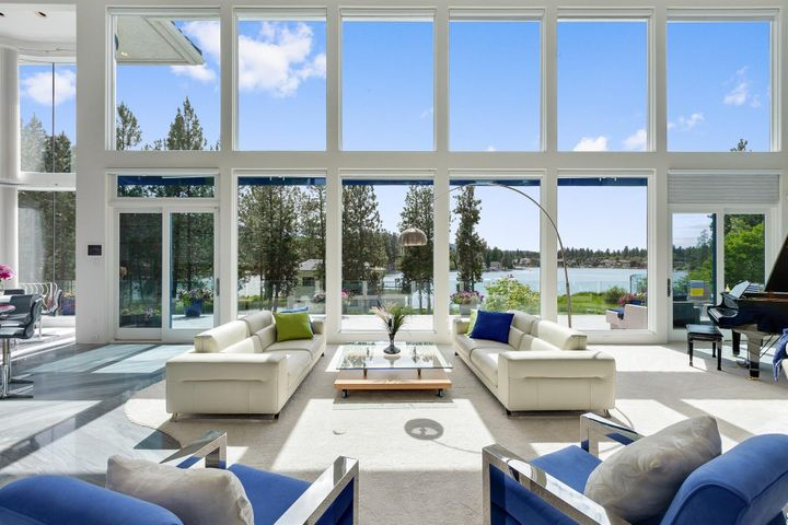 Most Extraordinary and Spectacular contemporary waterfront home in all of North Idaho. Architectural marvel with abundant natural light, 28 foot ceilings with floor to ceiling UV windows and inspiring entertaining spaces from the open great room, pool house cabana with living space, infinity pool, lush park-like grounds, this is the place to relax, unwind, and live life to the fullest. Boasting 8100+SF, 6 Bedrooms, right on the beautiful Spokane River with 200' of private waterfront and your own dock, rare 6-car attached garage and an underground storage garage, 5 acres of gated privacy and a privacy conservation inlet view for watching wildlife. More photos at www.SpokaneRiverfrontBeauty.com. Sunsets beyond compare, savvy and distinctive living for the True Connoisseur of Life!