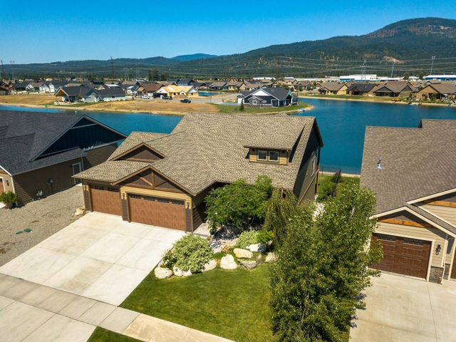 Don't wait for new construction! Check out this beautiful custom waterfront home on Radiant lake! Daylight walkout basement on the water in a gated community. Upgrades include 3 car garage on main level with a tandem 3rd bay, a garage on the lower level to store all the water toys and accessories, Granite counter tops, A/C, fully fenced and landscaped yard with covered back deck and patio overlooking beautiful Radiant Lake. W/D hookups upstairs and down stairs. 9' ceilings upstairs and downstairs, plus an outside shower to clean off before coming inside! Don't miss your opportunity to own your own piece of paradise in this gorgeous location and community.