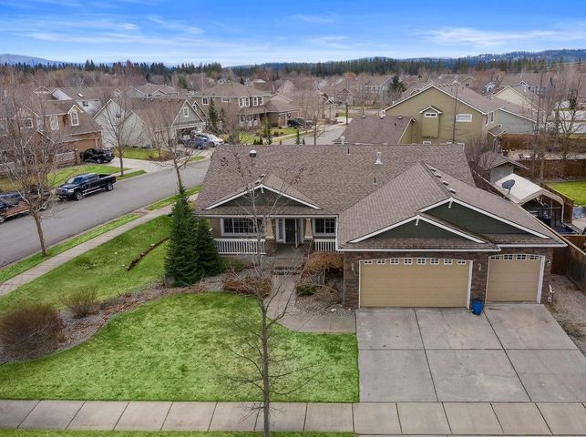 A beautiful home in one of Coeur d' Alene's best neighborhoods, ''CDA Place''. This Rancher has a main-floor master suite, main-floor laundry room and a fully finished basement.  It has a total of 5 bedrooms, 3 bathrooms and is 3,486 sq ft. It has a 3-car garage and is located on a quite corner lot, nearly a 1/4 acre in size. This home has an upgraded kitchen, custom cabinets, stainless steel appliances, built in office cabinets, LVP flooring, a jetted tub in the master bathroom and much more. The home has a large landscaped backyard with a covered patio and gated pet run.  This home is a short distance to 3 schools, numerous greenbelts and Blue Grass Park.