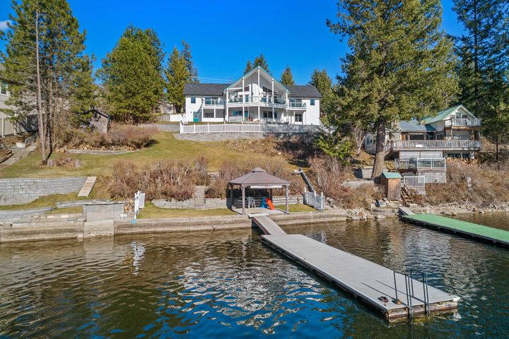 Twin Lakes - Must see this home and setting.  102 feet of excellent frontage.  Southern exposure, views are exceptional from spacious deck areas.  Home features kitchen with great room concept and vaulted ceilings.  4500 square feet, 4 bedrooms and super family area.
