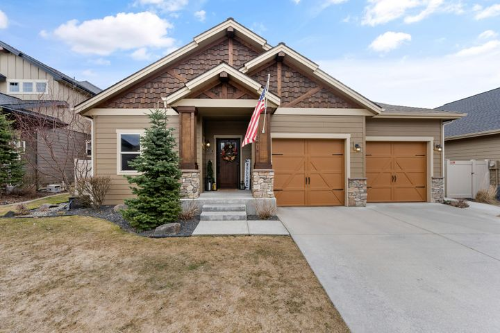 Better than new craftsman single level home on a quiet street in Coeur d'Alene Place! This 4 bedroom, 3 bath plus den/office is immaculate and will not disappoint. A dream layout with an open living concept, including private main floor master suite and laundry/mud room. A fully finished basement includes a family room/theater room, extra large bedroom, full bath and lots of storage. The backyard is fully fenced and beautifully landscaped with an extended paver patio for those relaxing evenings. The three car tandem garage is finished and has plenty of storage for your toys. Close to parks, community walking trails and schools. Turn key and ready to go!