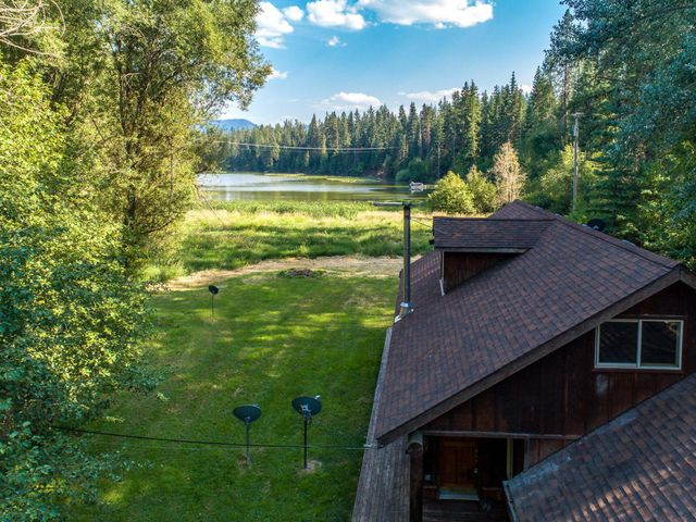 Enjoy the captivating lake views while you drink your morning coffee, read, sunbathe or just relax with a glass of wine on this private waterfront property. This unique property offers plenty of space for entertainment boasting 1.67 acres. The detached 3 car garage has plenty of space for all of your toys and an additional 1,000 sq. ft. right above perfect for game nights or additional living space. The property also features a guest cabin making it a perfect waterfront retreat. Sportsman Access is only 30 seconds up the road for boat access and the national forest with hundreds of thousands of public land minutes away.  This is one of the few properties with level grass to water properties making it a one of a kind. Additional 7.5 acres available! MlS- 20-2707.(Seller Financing Available)