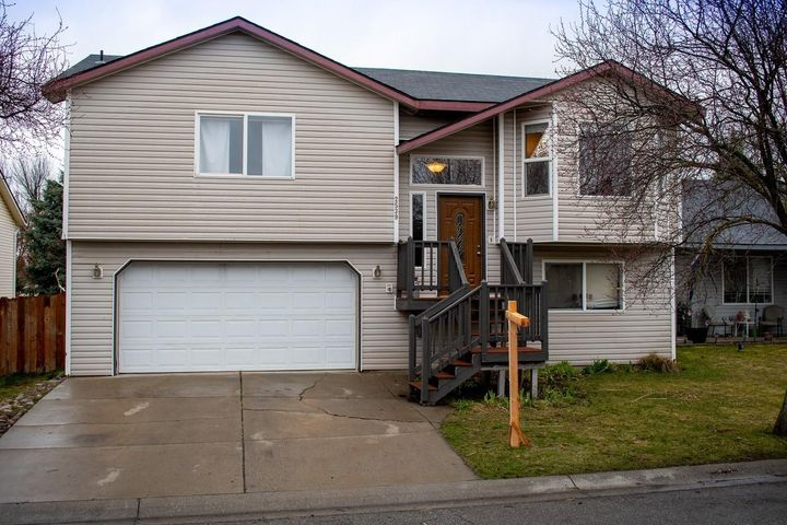 Beautifully maintained 3 bedroom 3 bathroom home with back yard gate access to a private park! Centrally located in Coeur d'Alene Place, on a private road that is maintained by the HOA. This home has a fully irrigated sprinkler system in the front yard and back yard with front gate access. The back yard is fully fenced with large deck, wooden play structure and shed! The Home Features an open concept layout with a gas fireplace and TWO master Suites! New flooring has been installed in the living room and kitchen areas, along with a brand new fence and roof to be replaced April 27th! Garage Shelving and Kitchen Refrigerator are included!
