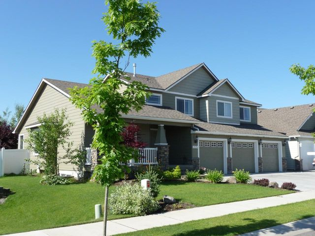 Welcome Home .. to the very popular 'Pine Mist' model by Greenstone Homes in Coeur d' Alene Place. Enjoy a wide open floor planwith plenty of room for everyone. Large open kitchen with center island, formal dining, (3) separate living areas, hardwood floors, A/C, built-in shelving unit around a tiled gas fireplace, & an efficient pellet stove in the finished basement which is plumbed for an additional bathroom. Beautiful landscaped yard with full sprinkler system & matching garden shed. Coeur d' Alene Place is a true master planned community that offers a wonderful lifestyle with several parks, greenbelts, miles of walking trails, and supper convenient to K-12 schools. *Agents: Please review showing instructions in private comments.