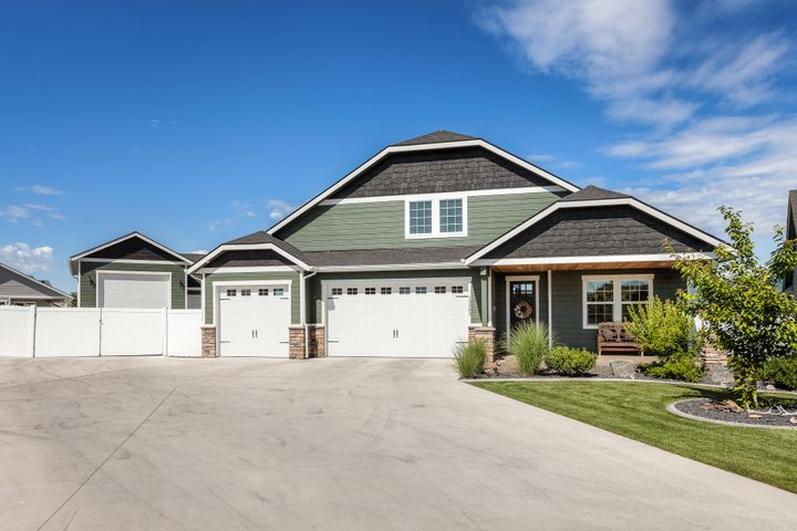 Check out this immaculate 3 bed, 3.5 bath rancher in Rathdrum, with great curb appeal, a beautiful landscaped front and backyard, a paved driveway all the way through to the large detached Double Bay Shop! The first RV Bay is 18x42 & Second Bay is 22x32, shop is completely insulated with a bathroom. Step inside and enjoy the vaulted ceilings and custom gas fireplace in the Living room. The kitchen compliments the design with a spacious pantry, custom cabinetry and concrete countertops throughout. The large master bedroom is complete with a walk in master closet, bathroom with a double vanity and oversized tiled shower. The extra large 3 car garage has plenty of storage room. The back covered patio is all set and ready to go for all of your backyard get togethers.