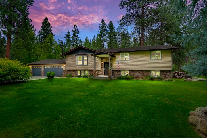 Beautiful  Post Falls home with WATERFRONT ACCESS! This 5BD/3.5BA home boasts 3,120 sq.ft. on over half an acre with room for a shop. In the open kitchen you'll find custom cabinets, stainless appliances, breakfast bar, double wall ovens & pantry.  The spacious master suite includes a dual sink vanity, beautiful step-in tile shower & walk-in closet. Features engineered hardwood floors, 2 wood burning fireplaces, A/C, updated plumbing & electrical, new cedar siding, Insulated  Finished  Garage and a newer roof. Don't miss this great opportunity to enjoy living on the north side of the river, on county land with waterfront access and community docks!