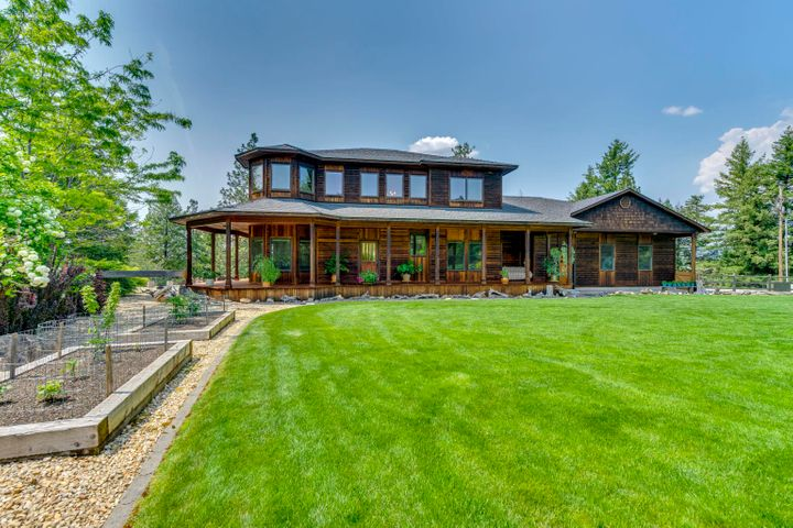 All you hear is the river. Down a gently winding drive you will come upon this gorgeous custom cedar craftsman home on 2.45 treed acres with 475 feet of Spokane riverfront. Picnic, swim, fish and kayak on your own private property. This home is over 2700 square feet and features hardwood flooring, river views galore from wood wrapped Pella windows. Unique slate and tile through out this beautiful home, a large master suite with a walk-in shower with Kohler 9 jet system and a jetted spa tub. Private well produces 100+ GPM. Relax on the covered redwood deck overlooking a private beautifully landscaped yard while the sounds of the river wash your cares away. Eagles, hawks, birds and wildlife abounds. This property is a one of a kind immaculate home is Truly the North Idaho Dream