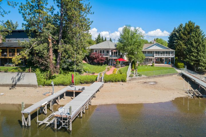 SPOKANE RIVER - Must see this waterfront home, grass to water.  Home offers in-law or guest quarters, separate 30' X 30' shop plus extra land to expand.  Nicely updated home with 4 bdrm/2.5 ba.  Nice dock with boat and jet ski lifts, southern exposure.