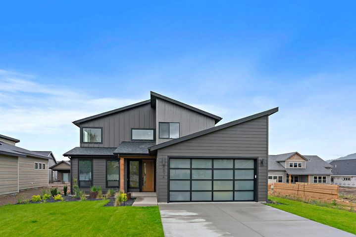 MOVE IN READY! Why wait to build? This gorgeous, modern Parade home built in 2019 is ready to go and comes with all the upgrades. This multi-story home features 2,270 sq/ft 3 bed/2.5 bath,  master bedroom suite, quartz waterfall countertops, luxury vinyl plank flooring, massive walk-in pantry, glass garage doors, gas linear fireplace, Bosch stainless steel appliances, gas firepit, front/back landscaping, covered patio, vinyl fenced backyard and much more. You will love the open concept and all of the natural light from this one of a kind floor plan. Close to schools, parks, and trails, you will fall in love with this charming neighborhood. Call for a showing today!