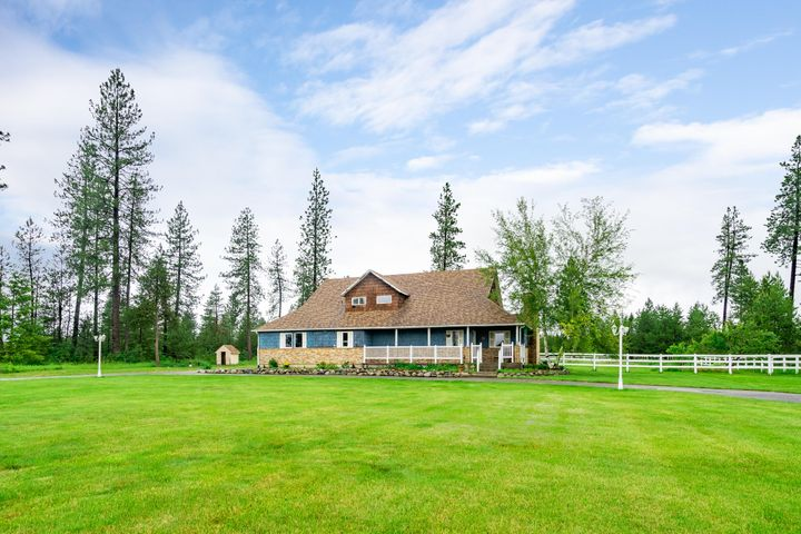 Awesome buy! Move in ready with lots of potential to grow! Just minutes from schools, grocery stores and remote enough to have your own space. This 5+ acres corner lot home has fruit trees, a start set up for horses, garden area, Bon fire pit and so much more. Kick off your shoes and own this rare find!
