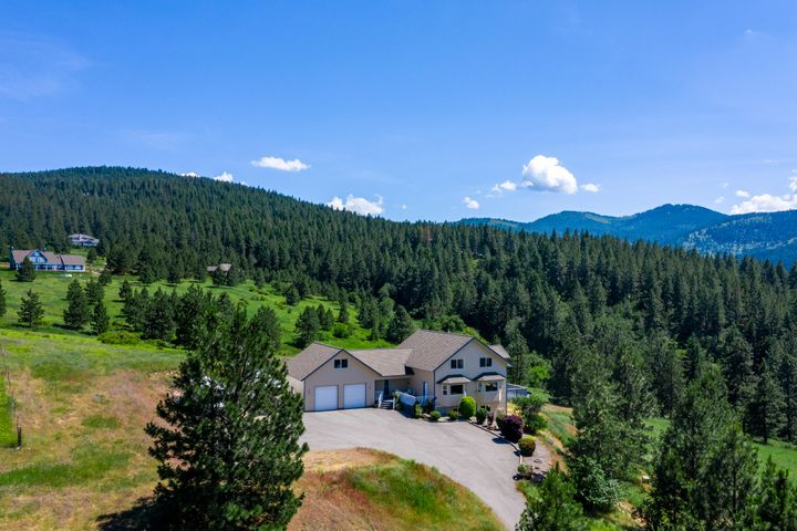 Gorgeous 10 acre horse property with breathtaking views and beautiful home! This house features 5 beds, 5 baths, 4,916 sq ft, master suite with full bath & garden bathtub, living room with a fireplace, vaulted ceilings, tons of natural light, laundry room with storage, bonus room & bedroom on upper level & beautiful views from every room. Large kitchen features SS appliances, stone countertops, & breakfast bar, basement includes a large family room with a woodstove. Outside enjoy tons of parking for your boat or RV, 2 car attached garage, beautiful open deck, year-round pond & huge lawn. 26x36 2 story barn with top level hay storage, electricity & water, 2 metal stalls with run-outs, conversation panels & swing-out water buckets & hay bins, tack room & 3+ acre pasture with electric fence