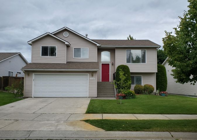 Nice home in desirable Coeur d'Alene Place. 4 bedrooms/3 baths, across the street from a large beautiful park and close to schools.Fenced yard with nice landscaping. Great neighborhood for taking walks and biking. Centrally located for all amenities. Easy commute to Spokane.
