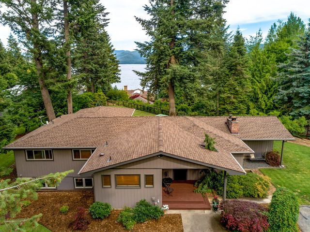 LOCATION, LOCATION, LOCATION! Seldom does an opportunity like this come up: located in town this picturesque Hayden Lake view home sits on the famous Easy Street in ''The Hayden Lake Country Club Grounds'' where only a few homes are situated. Both levels recently remodeled and built to take in the unobstructed Hayden Lake views & sunrises. 5 bedrooms, 3 bathrooms, and expansive windows to enjoy the view all year long. Large back patio and perfectly maintained landscape keep it private and tranquil. Easy main level living makes this a great opportunity for all; from younger to older. Drive your golf cart to Hayden Lake C.C. or Avondale and the Porch Restaurant, or take the short stroll to Honeysuckle Beach! Why live in North Idaho? Here's Why!