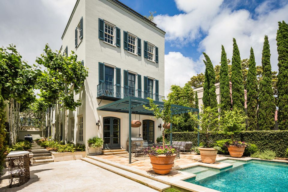 Private, Pristine, and Expertly designed, this 3 story masonry Charleston Single House with a pool and separate guest house sits on a ''street to street'' lot on East Tradd--South of Broad. Sophisticated and charming, this marvelous home is in turn-key condition and provides a level of interior finish and detail the most discerning buyer will appreciate. This high lot is located in a non-hazardous X Flood Zone, and the 5,947 ft main house boasts grand, light filled rooms room with high ceilings. Perfectly stained, hand milled heart of pine flooring can be found throughout the home. A combined dining, chef's kitchen and family room provides an brilliant space to dine and entertain family and friends. A substantial marble island with seating is the focal point of the kitchen,