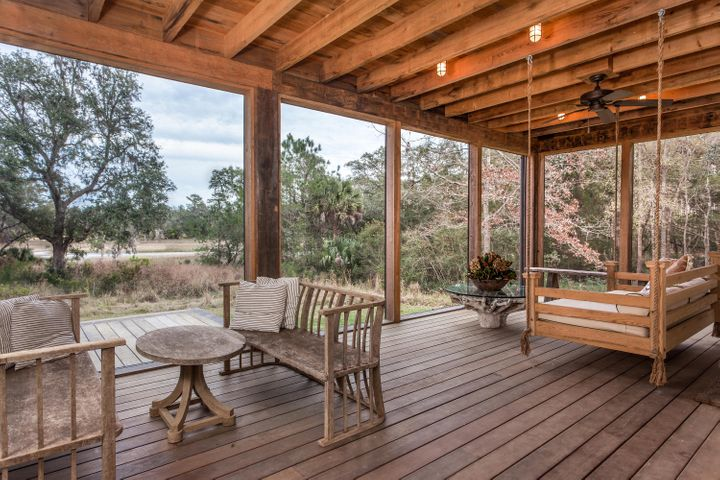 Retreat to the screened porch swing...most amazing view offering serenity in the quintessential Wadmalaw environment