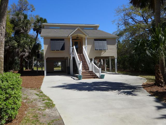 Front view of this fine home with new Bahama Shutters & front door!