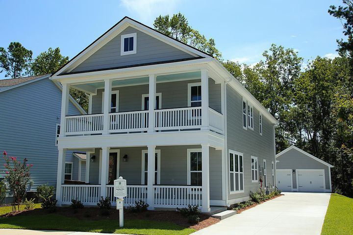 The Southern Charm of double front porches and a long driveway to the garage for plenty of parking!