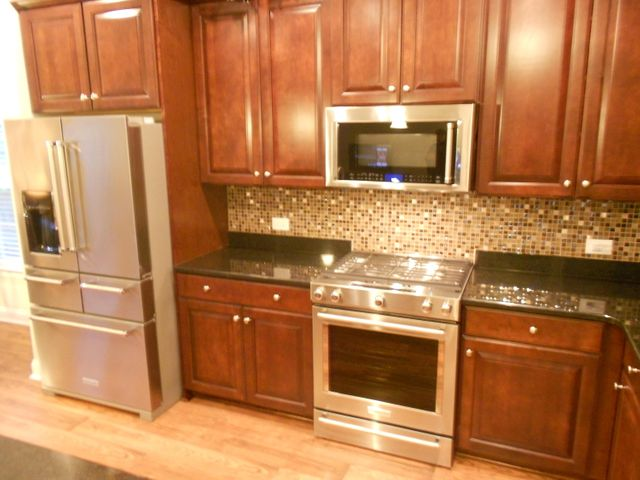 Wood kitchen cabinets and stainless kitchen appliances