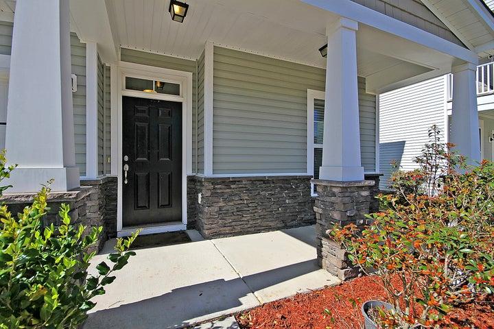 front door under covered porch