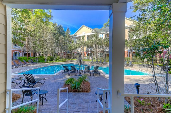 Immaculate condo with community pool located in Downtown Daniel Island! Within easy walking distance of shopping, restaurants, and the Family Circle Tennis Center!