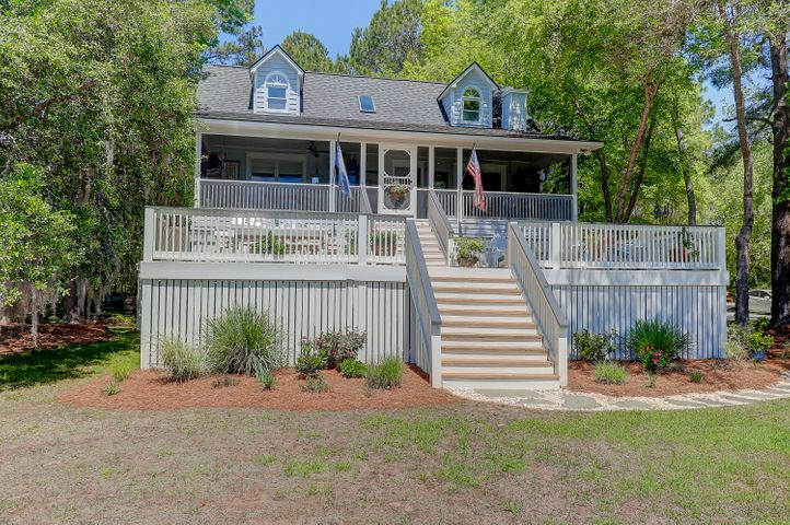 Front of home with views over the marsh and huge deck and screened porch to enjoy the breezes!