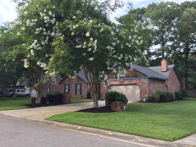 Beautiful brick ranch with new architectural roof and new gutters!