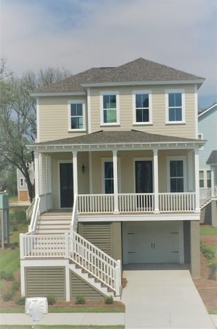 4 bed 3 bath drive-under home. LARGE front porch and HUGE screen porch.