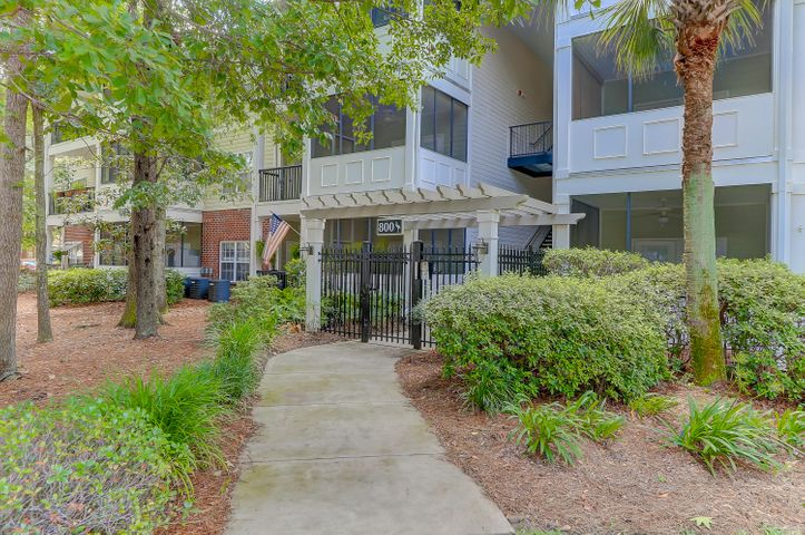 Ground floor condo in this gated building offers convenience and security just minutes to Downtown Charleston and Folly Beach! Note the beautiful, mature trees throughout this popular community.