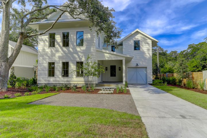 This beautiful modern coastal home complete with its variegated siding is located on a picturesque corner lot in Old Mt. Pleasant.