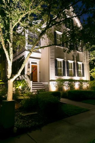 This elegant Daniel Island Park home is equally gorgeous in the evening as it is during the daytime.