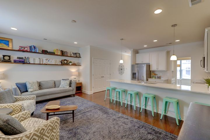 This immaculate townhouse boasts fantastic upgrades like wood floors and crown moulding throughout the first floor.