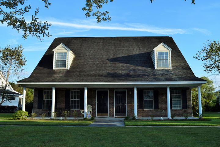 Great curb appeal with Brick front and lowcountry style front porch