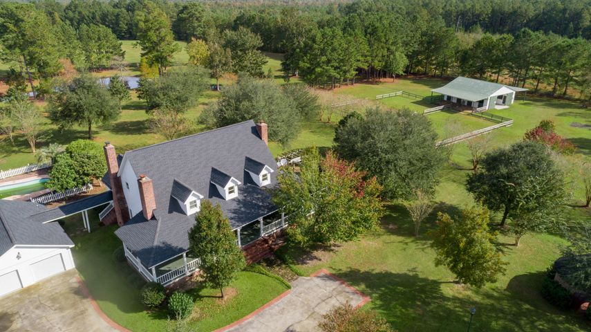 See the Pool, Garage, Barn, and Pond from the drone.