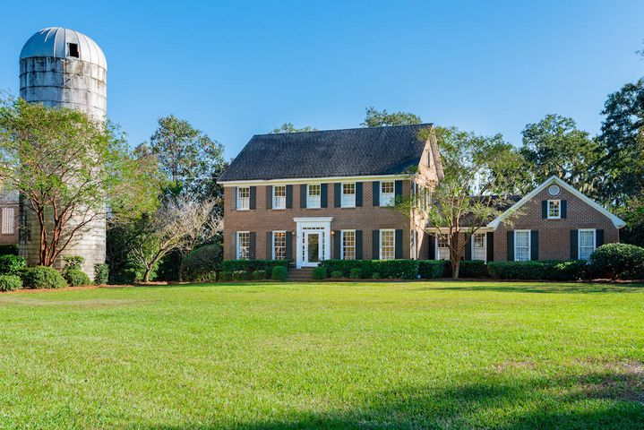 Handsome two story brick home on .82 acre and only 10 minutes to downtown Charleston.