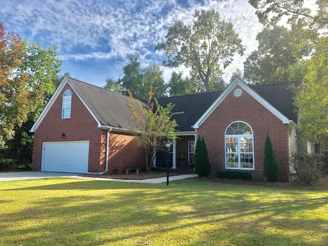 Ranch style brick front, set back on a large, wooded,cul-de-sac lot.