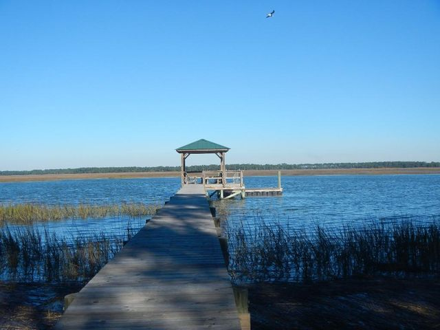Unique, Hard to Find Deep water property with short dock, covered pier head and floating dock and walk to beach!