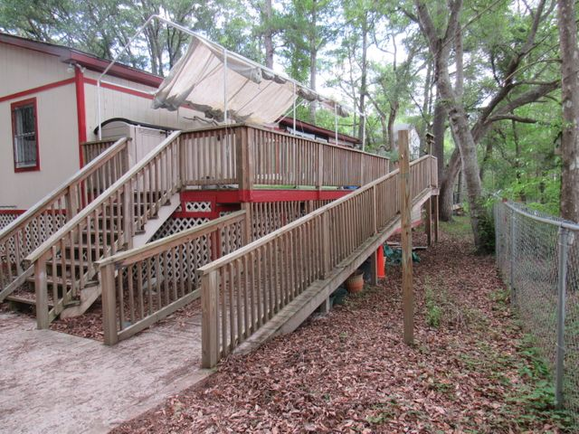 Huge Deck with utility ramp and stairs.