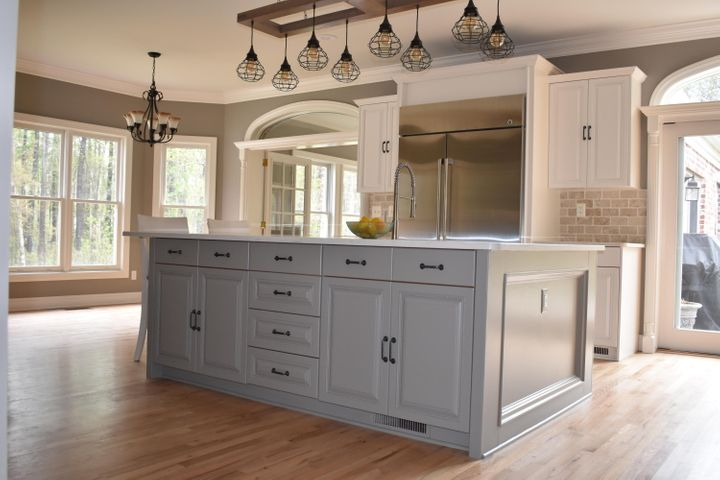 Huge island with granite and lots of cabinets