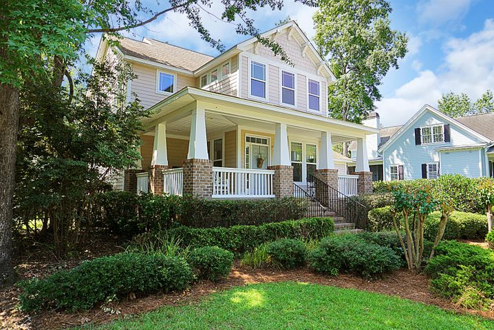 This craftsman style home has a gorgeous wrap around front porch.