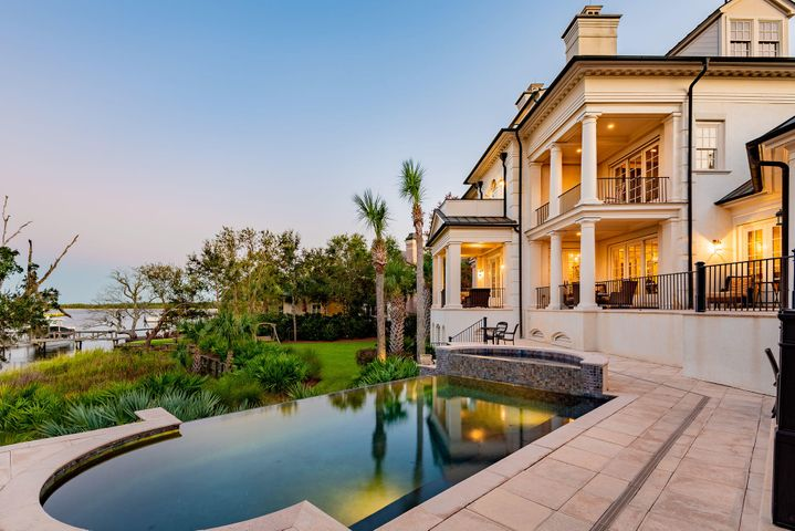 Phenomenal views of the Wando River are eclipsed only by the attention to detail in this home such as copper roofing and gutters, black walnut floors, and an impressive floating staircase that extends three stories.