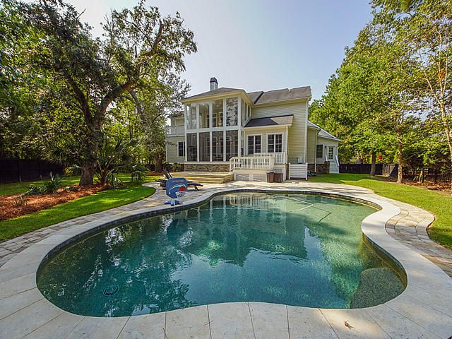 Gorgeous saltwater gunite pool overlooks a picturesque pond, wooded area, and walking trail.
