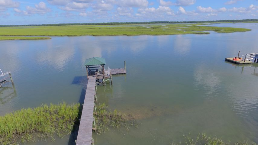 Deep water Property-with dock, minutes to light house --one of a kind, private street, walk to beach, light house and sunset view. Beautiful Palm Trees