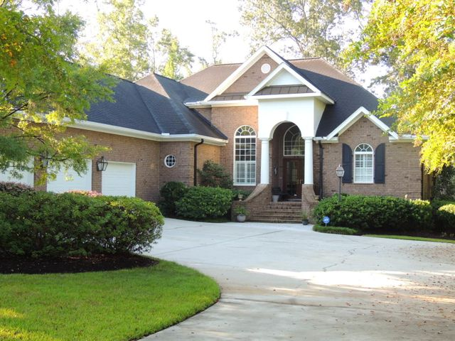 Custom built brick home on 10th fairway of Coosaw Creek Country Club. 3 Car Garage!