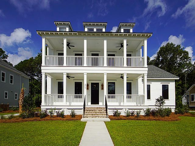 Gorgeous lowcountry home with double porches to take advantage of the breeze off 20 acre Bolden Lake just up the street