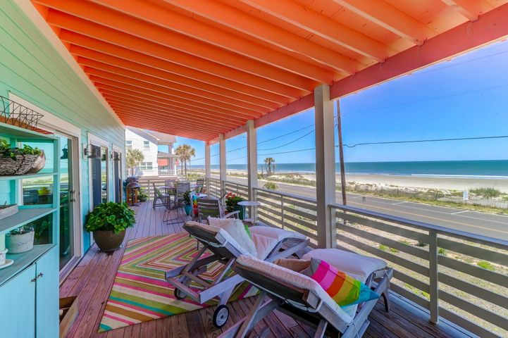First floor, spacious ocean front porch accessible by the dining and and living room, and master bedroom